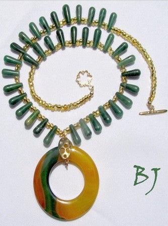 Brilliant Donut Drop Sits Among Golden and Green Beads-Adornments by BJ