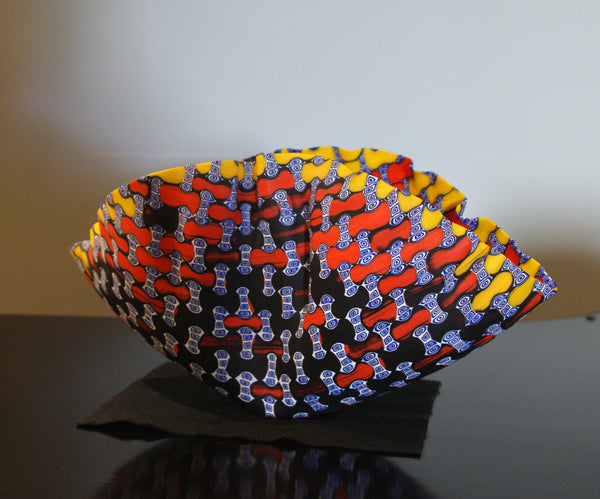 Orange, yellow, blue, black clamshell bowl