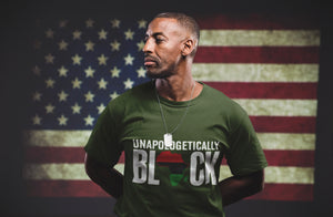 Chocolate Ancestor,LLC- black veteran wearing olive green Unapologetically Black unisex T-shirt