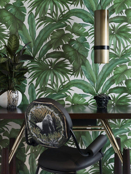 Versace tropical palm wallpaper features large scale hand painted green tropical palm leaves on a white background perfect for study or bedroom wallpaper