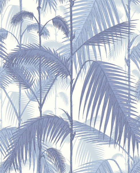 Cole & Son Palm Jungle wallpaper which features layers of blue palm leaves on white background
