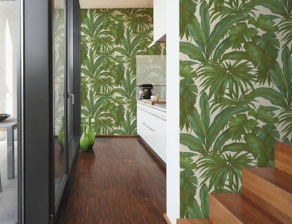 Versace tropical palm wallpaper features large scale hand painted green tropical palm leaves on a white background.