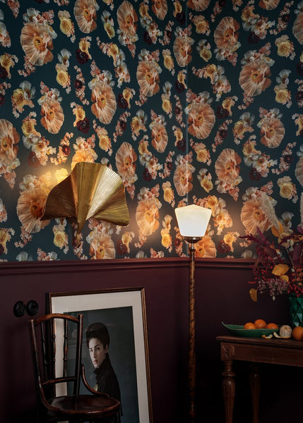 This Pompadour Poppy wallpaper pattern consists of poppies, anemone, sweet pea and persian buttercup against an opal green background.