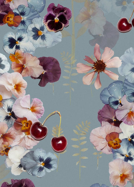 Cherry is a blossom rain in soft pastels against a soft blue background. Red cherries are scattered throughout the wallpaper.