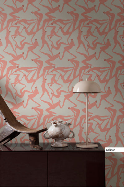 Laura Berger Wallpaper, features dancing figures in a pattern to create a create in salmon pink