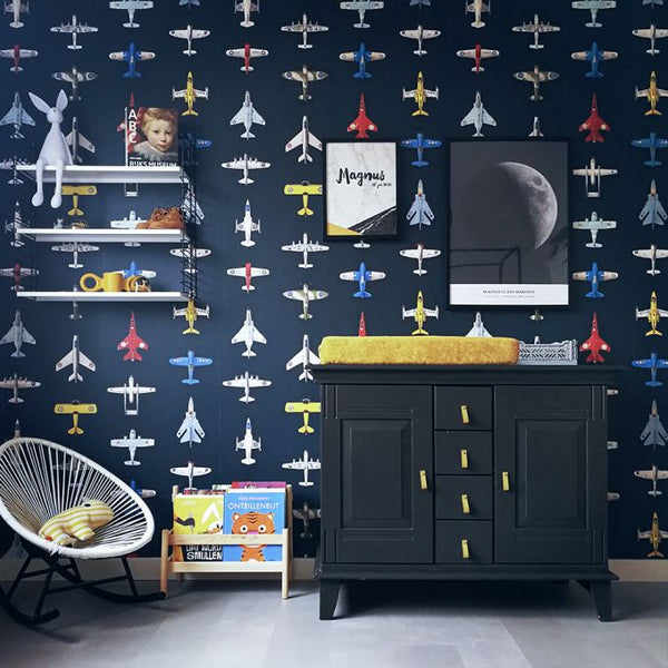 This fun and fanciful wallpaper is filled with perfectly lined up vintage airplanes against a dark blue background.  What a wonderful way to spark the imagination of your little one, telling stories of the trips and journeys you'll go on together one day.