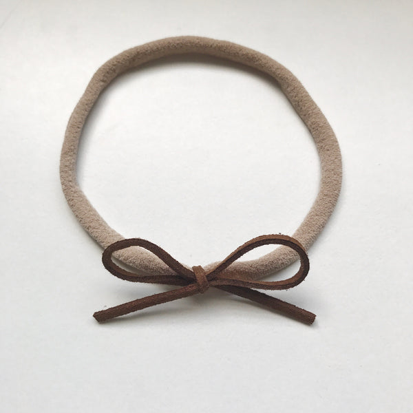 CHOCOLATE SUEDE BOW