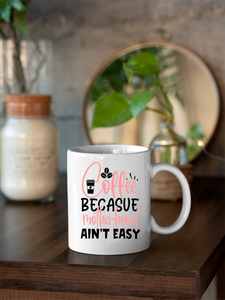 Coffee Because Motherhood Ain't Easy 11oz & 15oz Mug.