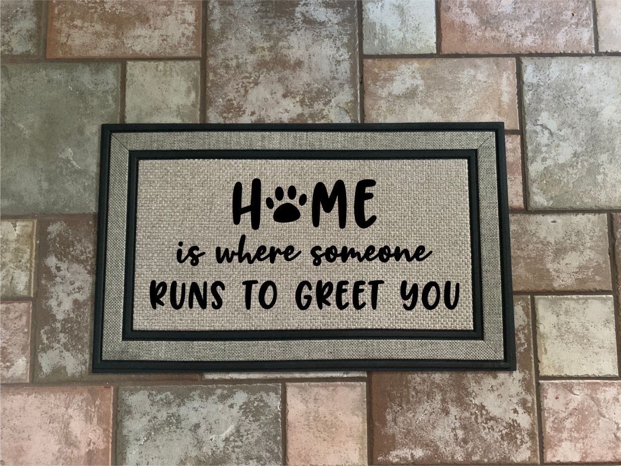 Home is Where Someone Runs To Greet You Door Mat.