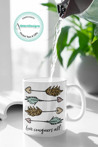 LOVE CONQUERS ALL MUGS-iStitchDezigns (3967620022366)