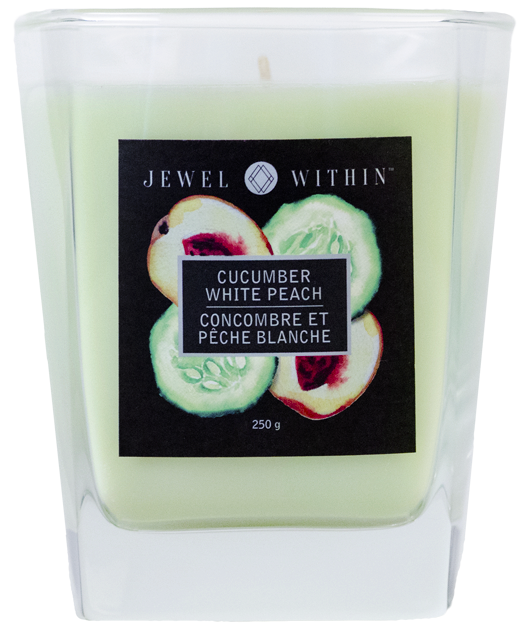 Cucumber & White Peach candles with jewelry inside from Jewel Within.  A refreshing cucumber charmed aroma with a hint of sweet peach.