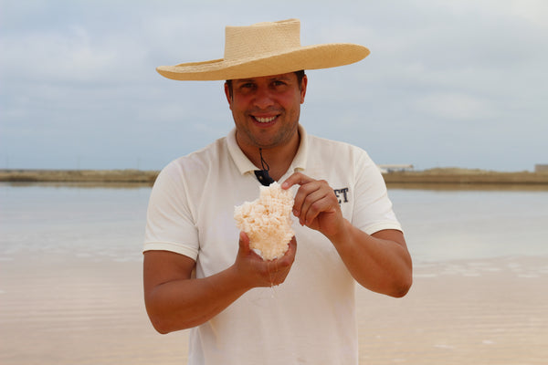 Brian Cajigas. Salt harvesting at the pond in Ecuador | MolinaSeaSalt.com