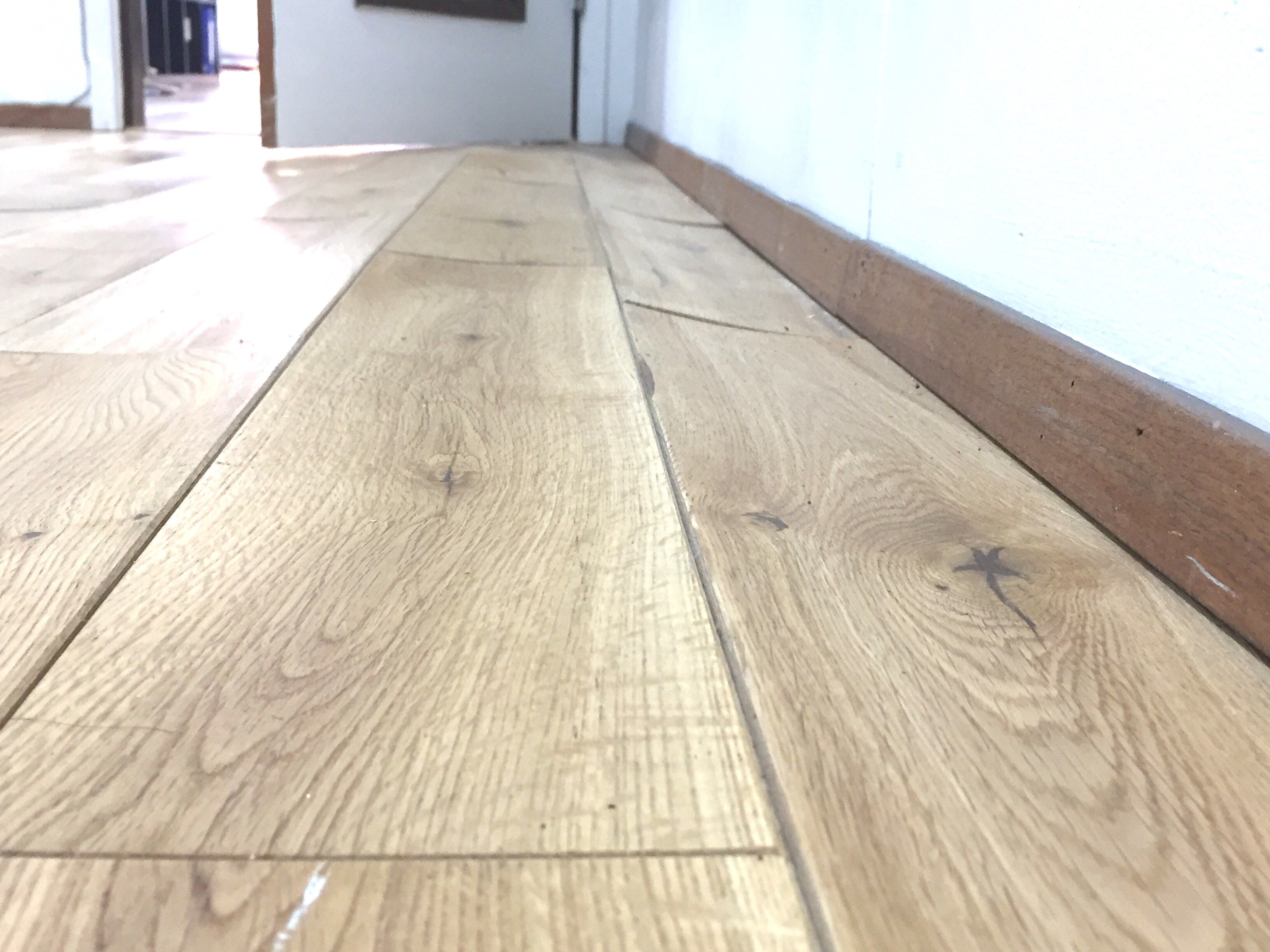 basement hardwood floor buckling and cupping