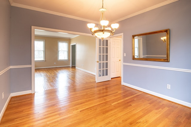 An empty house with great hardwood floors that need protection during a move.