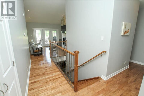 second floor flooring runs parallel to stairs