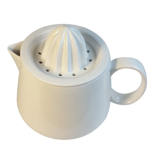 Manual citrus juicer reamer with white ceramic pitcher. Enjoy fresh juice!