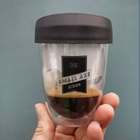Branded reusable coffee cup with Aeropress coffee
