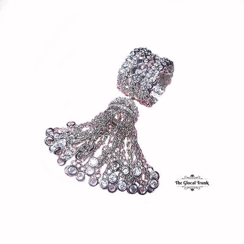 https://www.theglocaltrunk.com/products/temptress-crystal-tassel-ring