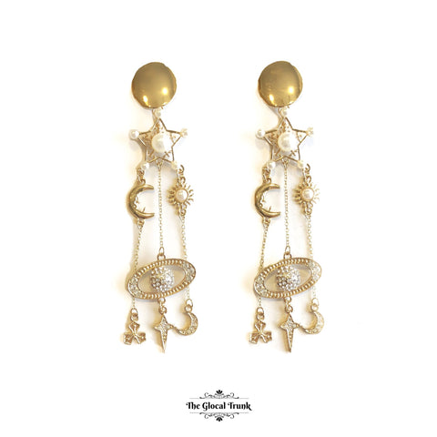 https://www.theglocaltrunk.com/products/stardust-pearl-metal-long-dangler-earrings
