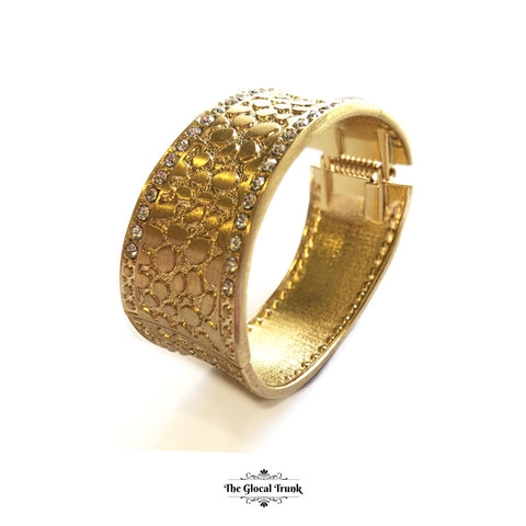 https://www.theglocaltrunk.com/products/bling-in-summer-textured-gold-stone-cuff