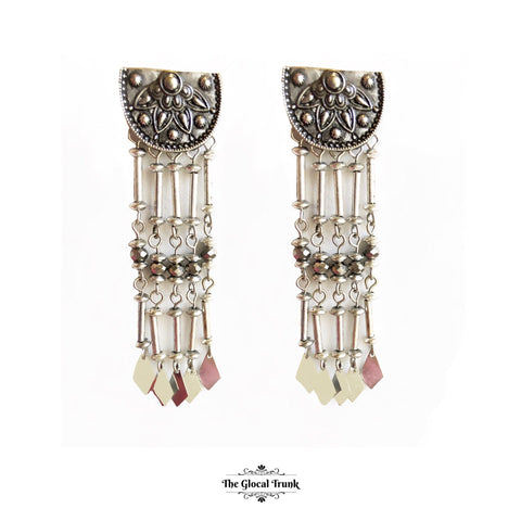https://www.theglocaltrunk.com/products/half-moon-tribal-dangler-earrings