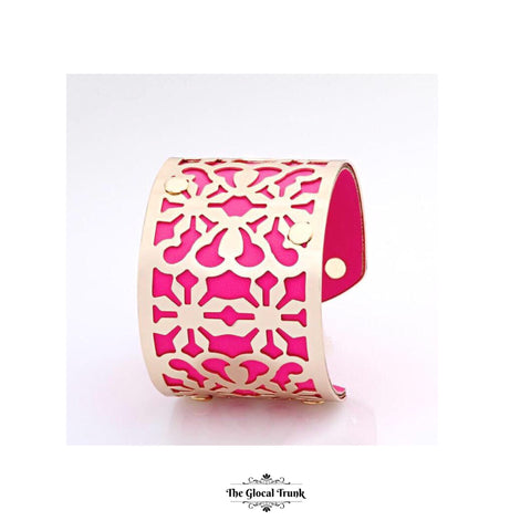 https://www.theglocaltrunk.com/products/lavish-cuff-mosaic-leather-metal-cuff-hot-pink