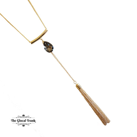 https://www.theglocaltrunk.com/products/droplet-long-tassel-necklace