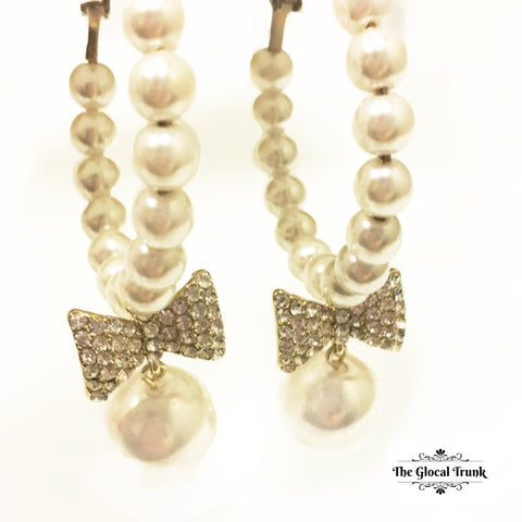 https://www.theglocaltrunk.com/products/annette-pearl-stone-bow-hoop-earring