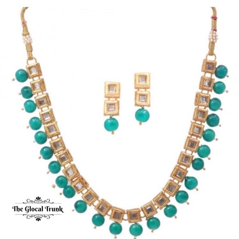 https://www.theglocaltrunk.com/products/kundan-green-pearl-necklace-set