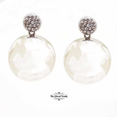 https://www.theglocaltrunk.com/products/reflect-crystal-and-gloss-metal-earrings