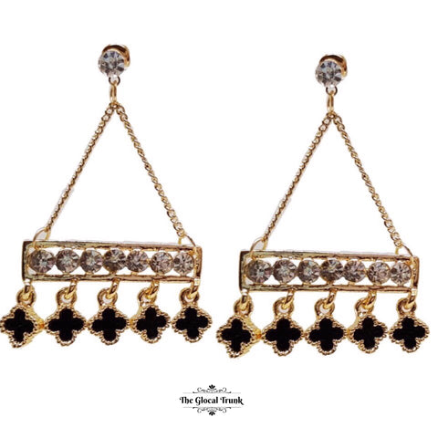 https://www.theglocaltrunk.com/products/karma-enamel-and-crystal-dangler-earrings