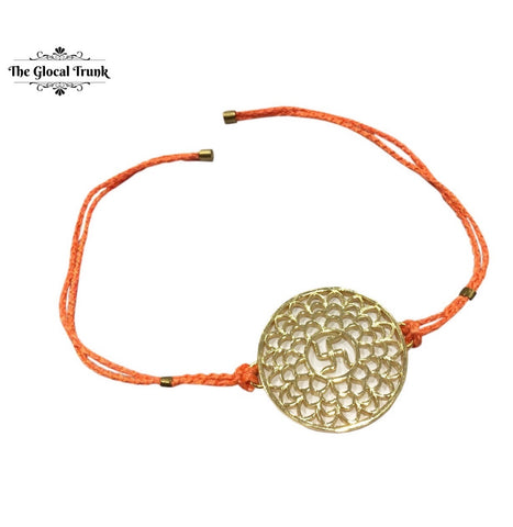 https://www.theglocaltrunk.com/collections/rakhi-collection/products/swastik-filigree-rakhi-orange-string
