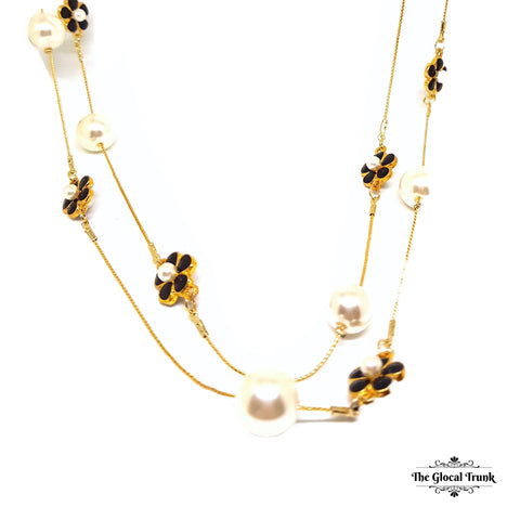 https://www.theglocaltrunk.com/products/pearl-and-black-enamel-flower-long-chain-necklace