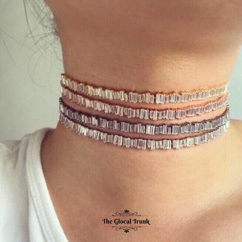 https://www.theglocaltrunk.com/products/petra-baguette-crystal-choker-grey-silver-gold-rose-gold?variant=32307465921