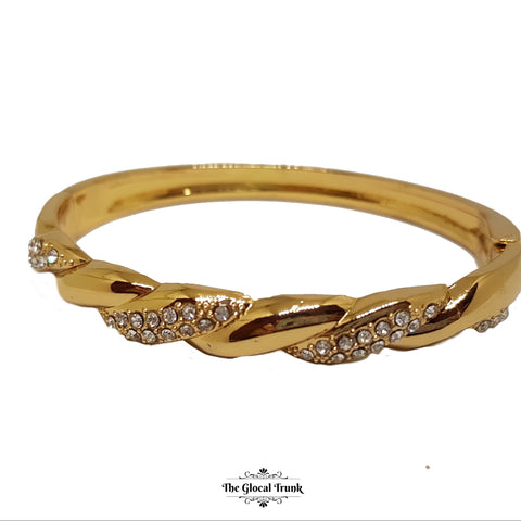 https://www.theglocaltrunk.com/products/braided-crystal-gold-slim-cuff