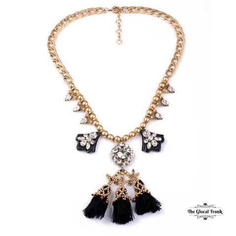https://www.theglocaltrunk.com/products/fluid-crystal-tassel-statement-necklace