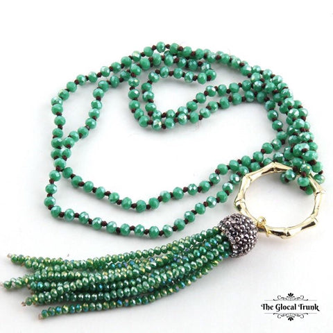 https://www.theglocaltrunk.com/products/metal-bamboo-circle-crystal-tassel-necklace-green