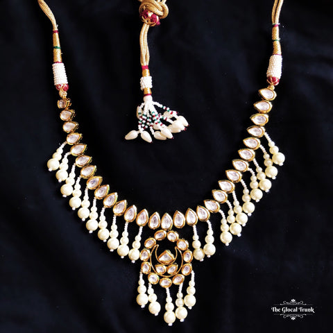 https://www.theglocaltrunk.com/products/sitara-kundan-and-pearl-dangler-choker-necklace