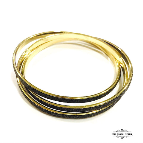 https://www.theglocaltrunk.com/products/intertwine-3-in-1-bangles