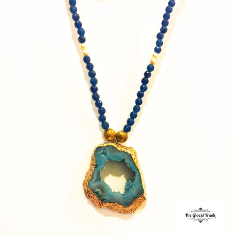 https://www.theglocaltrunk.com/collections/tgt-growth-buys-1/products/natural-stone-metallic-necklace-blue
