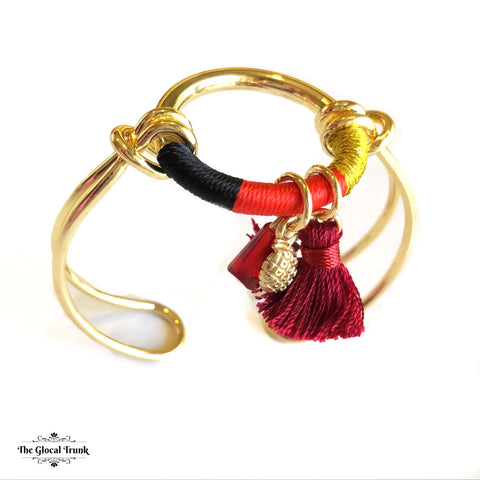 https://www.theglocaltrunk.com/products/anchor-me-tassel-bracelet-cuff-black-red-yellow