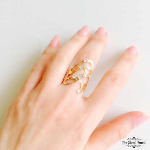 https://www.theglocaltrunk.com/products/cascade-wave-gold-ring