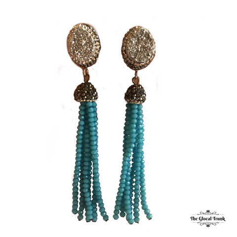 https://www.theglocaltrunk.com/products/paved-druzy-beaded-tassel-earrings-blue