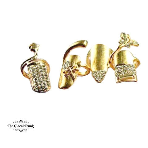 https://www.theglocaltrunk.com/products/duchess-set-of-4-nail-rings-gold