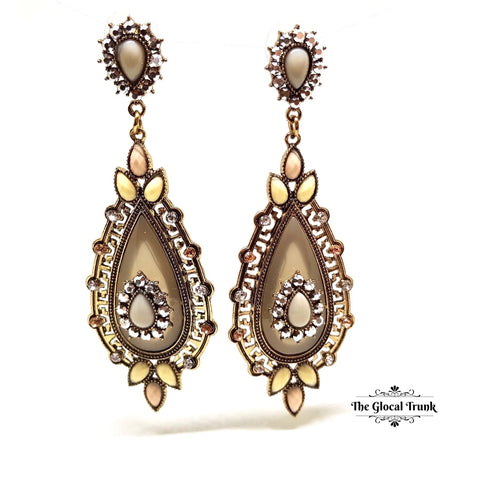 https://www.theglocaltrunk.com/products/adore-stone-and-crystal-vintage-earrings-khakhi