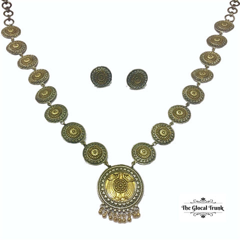 https://www.theglocaltrunk.com/products/two-tone-peacock-necklace-set