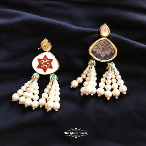 https://www.theglocaltrunk.com/products/jhoomar-kundan-and-pearl-tassel-earrings