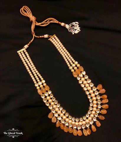 https://www.theglocaltrunk.com/products/rani-kundan-pearl-and-stone-drop-necklace