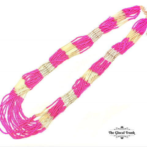 https://www.theglocaltrunk.com/products/boho-beaded-multilayer-pink-white-necklace
