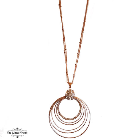 https://www.theglocaltrunk.com/products/concentric-rose-gold-and-crystal-long-chain-necklace